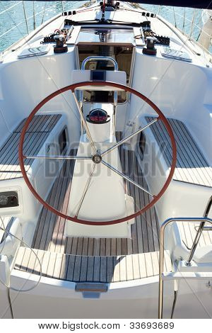 boat stern with big steering wheel and sailboat stern deck