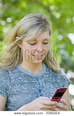 Young Girl Texting On Cell Phone