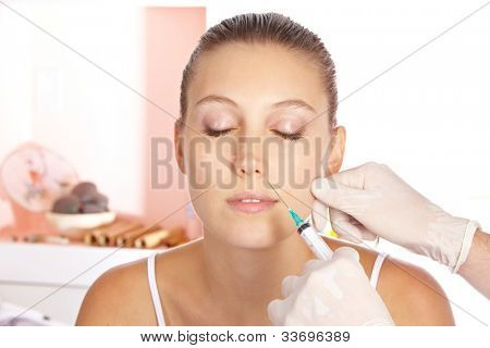 Attractive woman getting a wrinkle treatment with a syringe