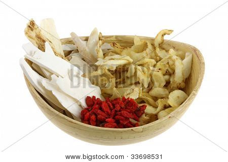 A bowl of Dried Chinese herb, to make soup, isolated on white