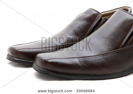 isolated pair of luxury brown leather man shoes on a white background, close up