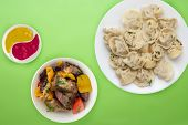 Dumplings On A White Plate On A Lme Background. Top View Of Dumplings With Vegetable Salad. Asian Cu poster