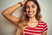 Young beautiful woman wearing red stripes t-shirt over white isolated background stressed with hand  poster