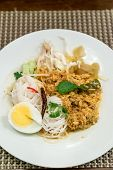Thai Rice Noodles with crab meat in Fish and Anchovy Curry Sauce poster