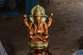 Close Up View Of Hindu God Ganesha Statue And The God Of Success With Blurred Background.focus On St poster