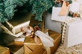 Photo Of Luxury Gift Boxes Under Christmas Tree, New Year Home Decorations, Golden Wrapping Of Santa poster