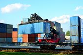 Shipping Container Loading By Richtracker On The Freight Rail Car At Logistic Warehouse Port. Ocean  poster