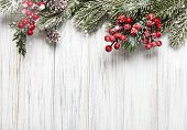 Christmas And New Year Background With Fir Branches, Holly Berry And Pine Cones On White Wooden Back poster