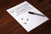 Stop Diabetes Sign On A White Paper Sheet With Sugar Cubes On Wooden Background, Prevention Disease, poster
