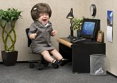 image of nervous breakdown  - Baby dressed in professional office attire crying at her desk - JPG