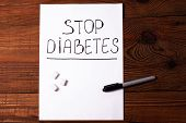 Stop Diabetes Sign On A White Paper Sheet With Sugar Cubes On Wooden Background,prevention Disease,d poster