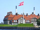 Royal Residence In Denmark With Red Roof poster