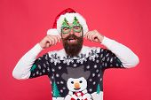 Be Fashionable And Celebrate. Happy Hipster In Fashionable Santa Style. Bearded Man Twirl Fashionabl poster