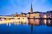 scenic view of historic Zurich city center with famous Fraumunster and Grossmunster Churches and riv poster