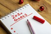 2020 Goals. Creative Inscription 2020 Goals Written In Notebook On A Wooden Table Background For D poster