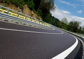 image of twisty  - Asphalt twisty mountain road in hills in Slovakia - JPG