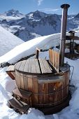 picture of hot-tub  - wooden hot tub in the alps with mountains behind - JPG