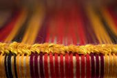 Detail Of Traditional Vintage Weaving Hand Loom With Wool Close Up. Weaving Background. Craftsmanshi poster