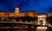 Royal Palace Or The Buda Castle  And The Famous Chain Bridge After Sunset With Lights Illuminated  I poster