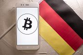 Cryptocurrency And Government Regulation, Concept. Modern Economy, Smartphone With Bitcoin Sign On T poster