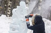 A Man Processes Ice. An Ice Cutter Works With Tools And Polishes Ice To Make A Frozen Sculpture At A poster