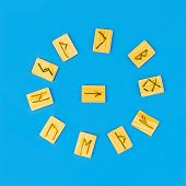 Fortune Telling On The Scandinavian Runes. Runes Lie On A Blue Background. poster