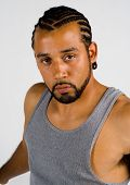 pic of cornrow  - African American male with cornrow haircut looking serious against a white background - JPG