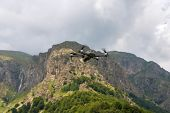Drone With Camera Flying Over Mountain Fields. Aerial Photography And Videography. poster