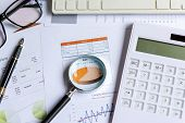 Magnifying Glass On Pie Chart With Statistics Accounting Info Which Including Of Many Economic Stati poster