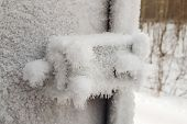 Metal Door And Door Handle And Keyhole Are Covered With Frost. Severe Frosts. Door Freezes. Icy Hand poster
