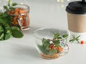 Healthy Herbal Tea With Sea Buckthorn Berries And Ginger. Glass Cup With Mint Leaves And Sea Bucktho poster