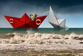 Rescue Concept. Red Paper Rescue Boat Of The Coast Guard Towing A White Boat That Are Sinking, In A  poster