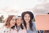 Happy Asian Girls Taking Selfie With Mobile Smartphone Outdoor - Young Trendy Social Friends Having  poster