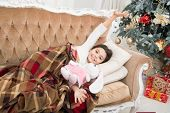Christmas Eve. Dreaming About Christmas Miracle. Small Cute Girl Dreaming About Christmas Gift. Happ poster