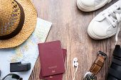 Passport With A Map On Wooden Background.travel Planning.top View Of Traveler Accessories With A Hat poster