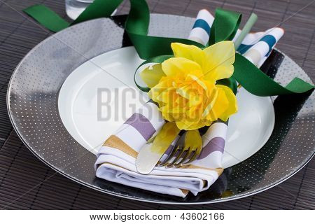 table serving with daffodil flower