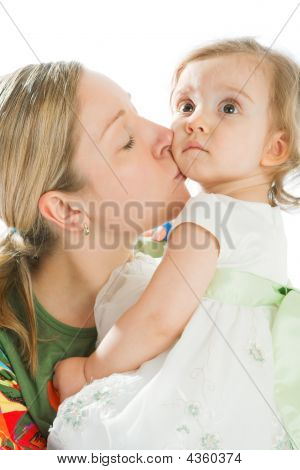 Mother Kissing Her Daughter