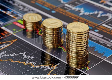 Downtrend Stacks Coins,on The Financial Stock Charts As Background. Selective Focus