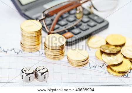 Downtrend Stacks Coins, Calculator, Glasses And Dices Cubes With The Words Sell Buy On The Financial