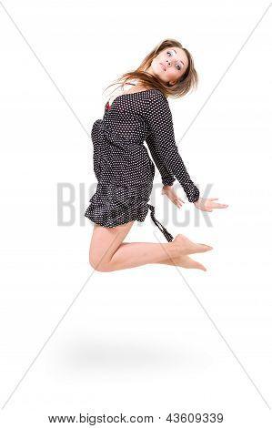 beautiful girl wearing a dress jumping up