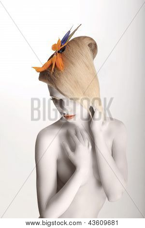 Fairy Tale. Artistic Dreamy Woman With Strelitzia Flower Posing. White Makeup