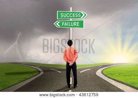 Businessman Choosing Success Or Failure Road