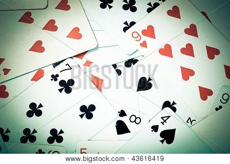 Large collection of used playing cards, closeup