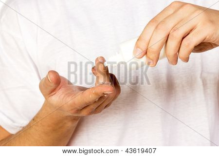 Closeup View Of A Man's Cleaning Corrective Contact Lens On A Finger.