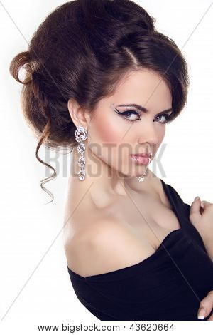 Beautiful Brunette Girl With Hairstyle And Make Up Isolated On White Background. Jewelry And Fashion