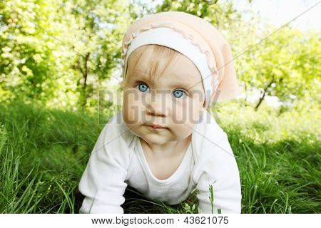 Girl Is Crawls On Grass