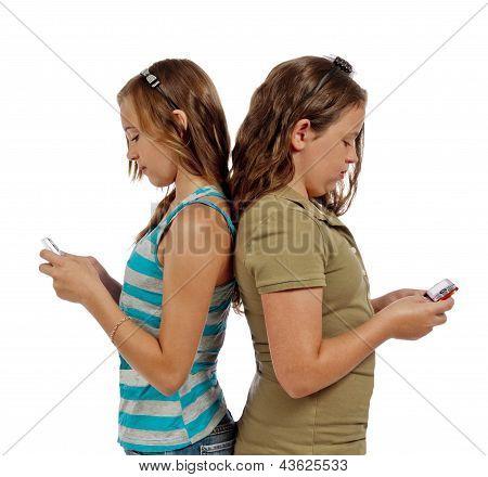 Teenage Girls Text Messaging Instead Of Talking