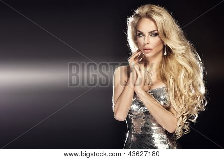 Portrait Of Elegant Blonde Woman Ready For The Evening.
