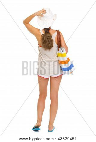 Full Length Portrait Of Young Beach Woman In Hat . Rear View
