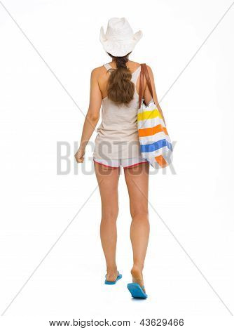 Full Length Portrait Of Young Beach Woman In Hat Going Straight